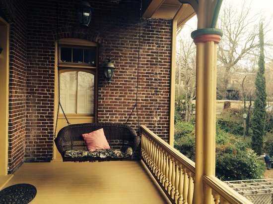 Ahern's Belle of the Bends : Second floor porch swing adjacent to the gardens