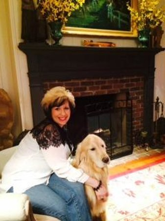 The Welsh Hills Inn: My wife enjoying the fireplace with Ellie