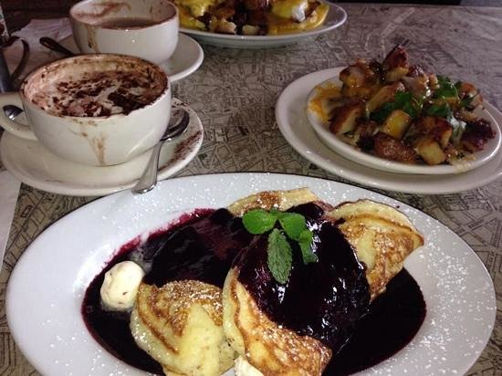 Alexis Baking Company: stuffed sweetened cream cheese pancakes with blackberry sauce, potatos with melted cheese and ho