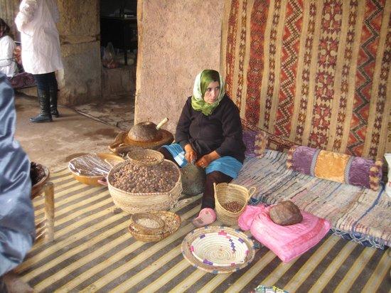 Morocco Attractive Tours: Berber women extracting Argan Oil