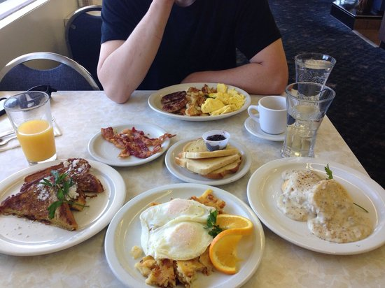 Owl Cafe : Biscuits and gravy, French toast, hash browns and eggs and a mimosa!
