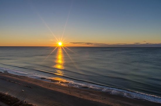 Camelot By The Sea, Oceana Resorts: Sunrise view from our room