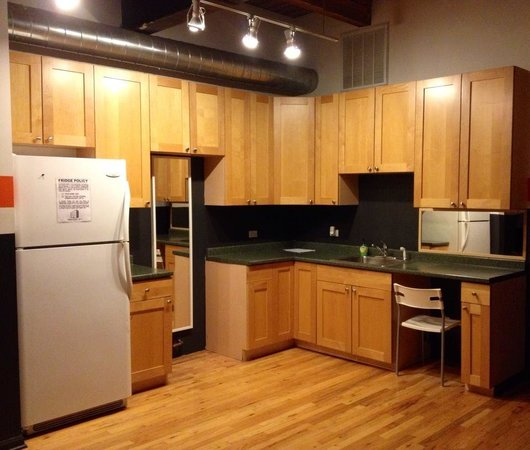 Urban Holiday Lofts: counter/kitchen area in the 8 bed female dorm