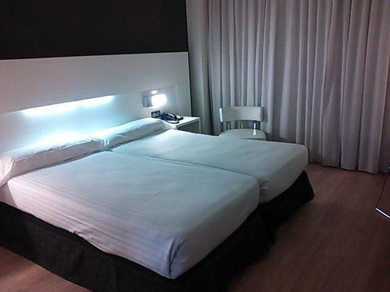 Axor Feria Hotel: ベッドルーム
