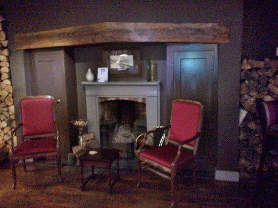 Blenheim House: Comfortable chairs near fireplace