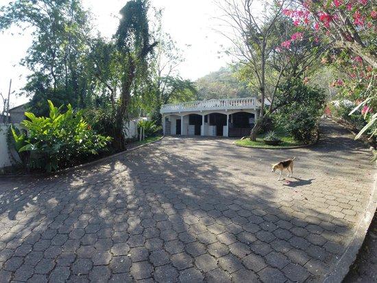 Hacienda la Esperanza: Looking south below the Hacienda at the horse stables. Note grand patio above.