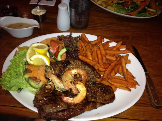 Barbican Steakhouse: My t-bone with sweet potato fries and I asked for some prawns they were great