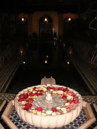 Pepe Nero : The mosiac pool lit by lanterns.
