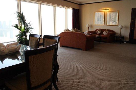Hilton Sharjah: King Ambassador Suite #1521, living room & ding area
