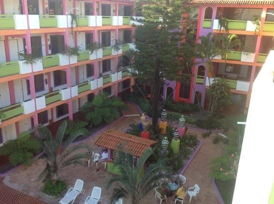Decameron Los Cocos: interior courtyard of los cocos building by beach