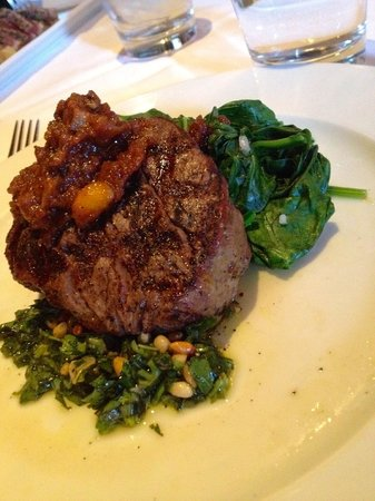 Snake River Grill: Eight-ounce Black Angus tenderloin with rustic pesto, tomato-bacon jam, and steamed spinach