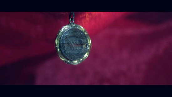 Bram Stoker's CASTLE DRACULA: A lock of Bram Stokers Hair hanging in a gold Pendant at Castle Dracula.