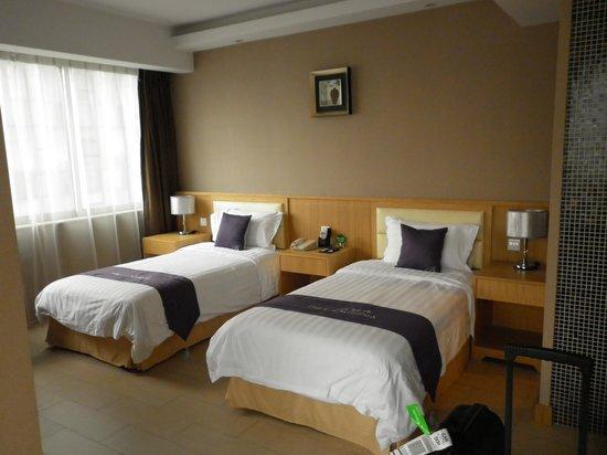 Guangzhou Bauhinia Hotel: Sovrum