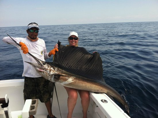 Wife and a nice sailfish picture of quepos fish for Quepos fish adventure