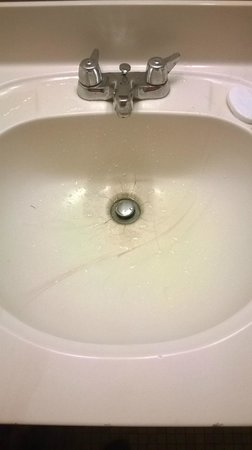 Millennium Buffalo: Sink with 1960s faucet and cracked sink.