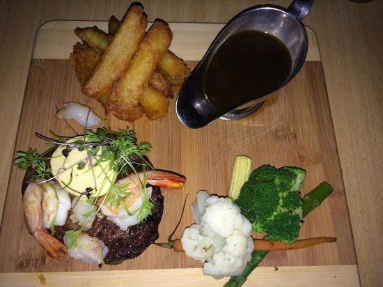 The Brass Bell: Main - 8 hour slow cooked rib fillet, roasted garlic butter prawns & bugmeat, hand cut chips, st