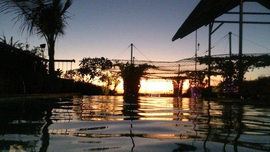 The Akmani Legian: rooftop pool/bar at sunset