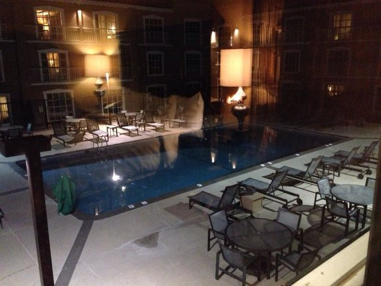 Hilton Santa Fe Historic Plaza: View from our room to pool and fireplace.