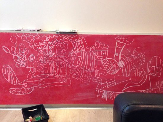 Eruption Cafe: A bright red chalkboard for the kids.
