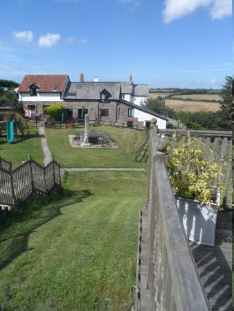 Robin Hill Farm Cottages: view of the cottages from the conservatory