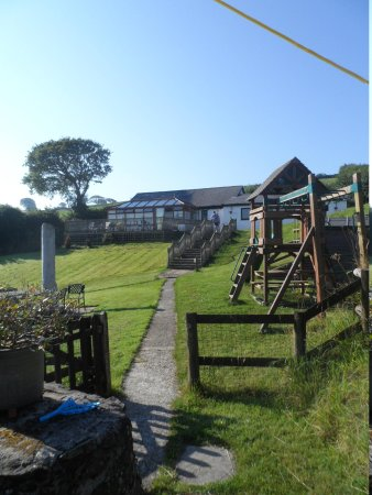 Robin Hill Farm Cottages: view of the conservatory, swimming pool and games room from Heron Cottage