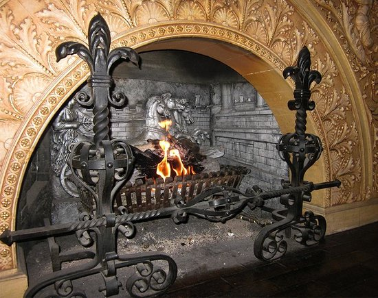 The Pfister Hotel : Fireplace at bar in lobby.