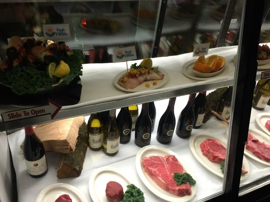 Charley's Steak House & Seafood Grille: Display of fine wines and meat when you enter the restuarant