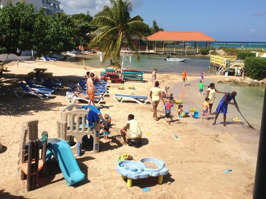 Franklyn D. Resort: Nannies out with kids on one area of the beach