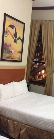 Cosmopolitan Hotel - Tribeca : Room 222 has two double beds partial brick wall with Faux Fireplace two Windows overlooking Stre