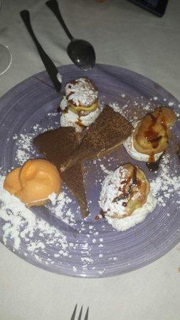 Casa julio : Lionesas. Sorbete de mandarina y tarta de chocolate