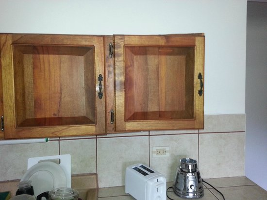 Manuel Antonio Estates: Kitchen cabinet falling off wall.