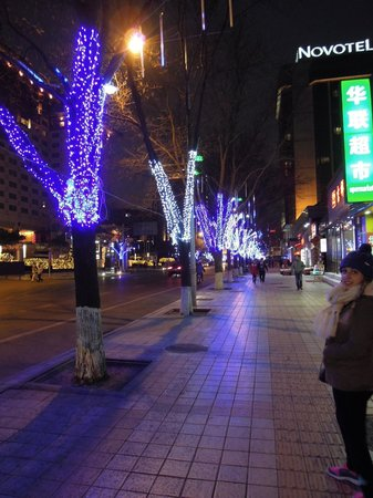 Novotel Beijing Peace : The street of the hotel at night.