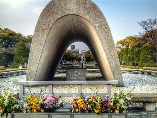 Hiroshima Peace Memorial Park : cenotaph in peace memorial park with genbaku dome at the back