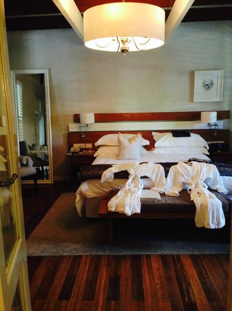 The Robertson Small Hotel : The Stable Suite with fluffy gowns waiting