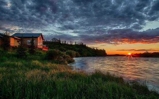 King Salmon, AK : Waterfront view of the lodge at Sunset on the Alagnak River