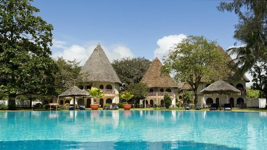 Galu Beach, Kenya: rooms in African cottages with makuti roofs