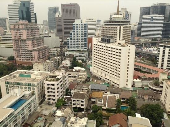 Bandara Suites Silom, Bangkok: view from 24th floor. saladaeng station is behind white building at centre of image. tents at ri