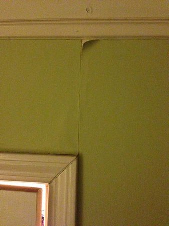 The Fitzgerald Hotel : Peeling and poorly installed wallpaper