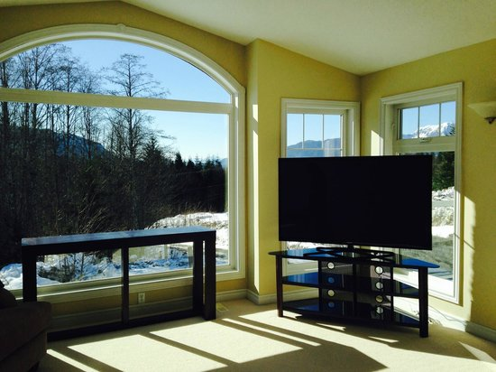 "The Kitimat Guesthouse : upstairs living room with 62"" LED TV"