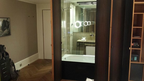 CORTIINA Hotel: View looking towards the bathroom with a panel that can be slid open of closed for privacy