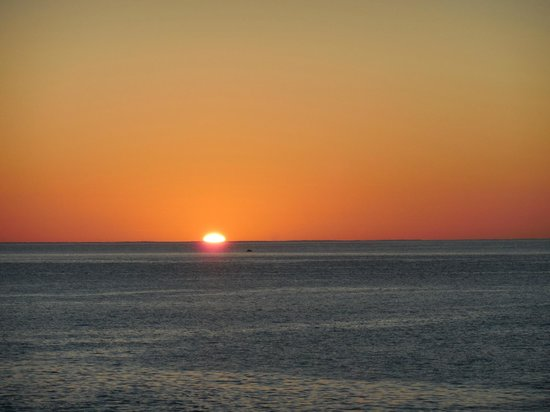 Sheraton Grand Los Cabos Hacienda del Mar: Sunrise last day --Yes that is a whale in the pic.  Great timing!