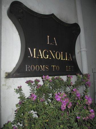 La Magnolia: Hotel's signage on the main street