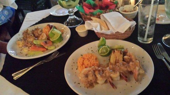 Camarones Al Tequila and Camarones Al Diablo at Carboncitos,  Playa del Carmen, Mexico