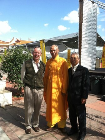 With the Buddhist monk at Qua Buang