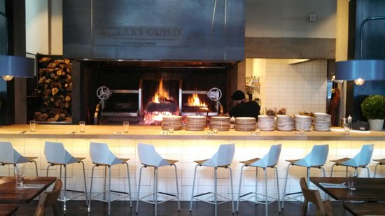 Miller's Guild: Dining counter and wood fired grill