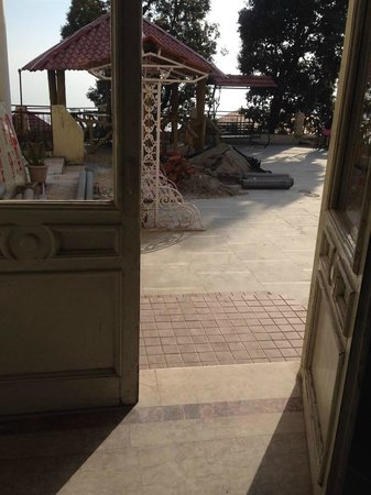Hotel Starz Regency: front sitting area with cement and sand piles
