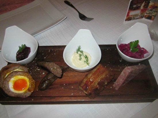 Empire Modern British Restaurant & Steak House: Sharing platter of pork - side garnish dishes