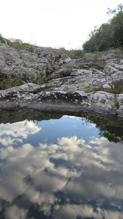 Estancia Aguila Blanca: Reflections of clouds in a creek we stopped at during a ride.