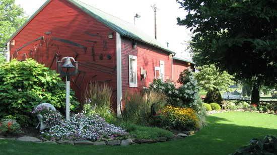 "The Grapevine House Bed and Breakfast: The back of ""The Barn"" surrounded by gardens"