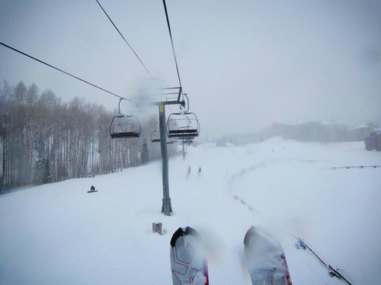 Snowmass Village Hiking Trails: snowing on the ski lift